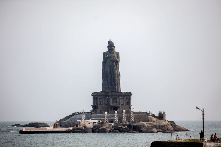 Scenic View Of Tall Statue In Sea Against Clear Sky