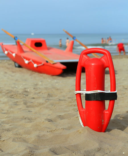 View of red boat on beach
