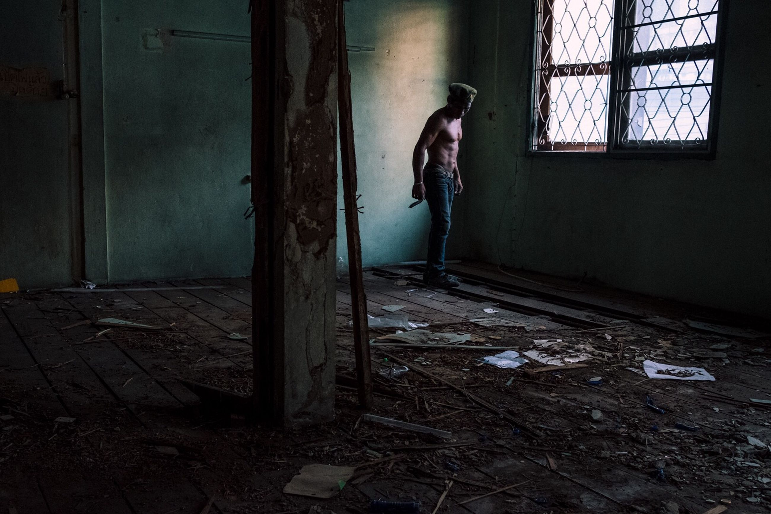 window, abandoned, full length, indoors, one person, real people, destruction, lifestyles, day, people