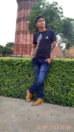 Day Dehli Full Length Lifestyles Men One Man Only One Person One Young Man Only Only Men Outdoors People Plant Portrait QutubMinar Standing Tree