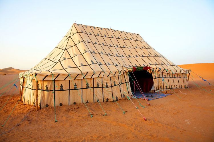 Tent In The Desert Against Clear Sky