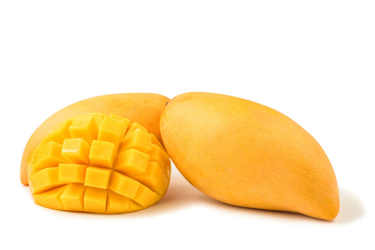 Mango fresh fruit with cubes and slices. Isolated on a white background and clipping path. Mango Isolated White Background Fruit Food And Drink Cut Tropical Organic Ripe Healthy Eating Sweet Dessert Juicy Slices Cubes Yellow Natural Freshness Object Macro Studio Nutrition Diet Gourmet Vegetarian Exotic Clipping Path South Citrus  Vitamins Closeup Pieces Sliced Stone CutOut Half Pattern Studio Shot Indoors  Food Close-up Group Of Objects Healthcare And Medicine Snack Vitamin No People