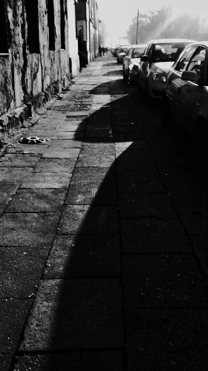 car, land vehicle, transportation, street, sunlight, shadow, the way forward, outdoors, day, road, no people, nature