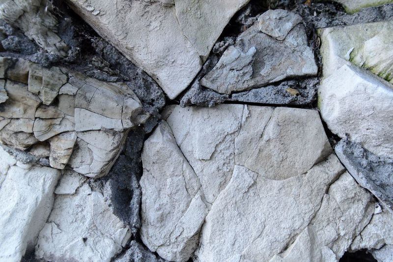 Stones Full Frame Backgrounds Textured  No People Day Pattern Close-up Rough Cracked Outdoors Nature Rock Rock - Object Natural Pattern Weathered
