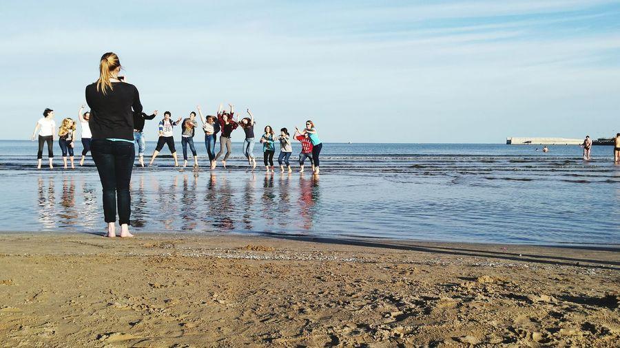 Friends At Beach Against Sky