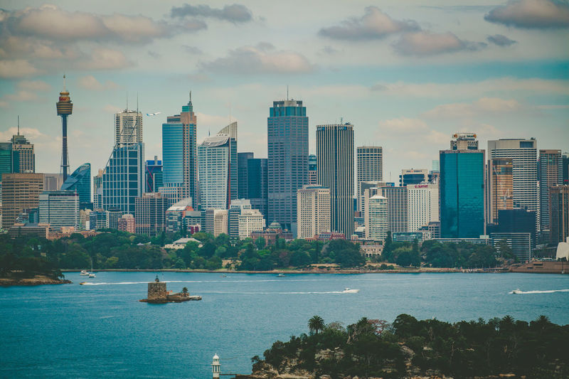 Sydney, Australia - October 3, 2017: Sydney CBD skyline viewved from the harbour Architecture Building Exterior Built Structure City Cityscape Day Growth High Modern No People Outdoors Residential  Sky Skyscraper Tall Tower Urban Urban Skyline Water