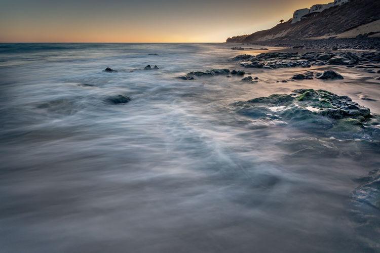 EyeEmNewHere Atlantic Ocean Fuerteventura Nature Tranquility Vacations Beach Beauty In Nature Coast Horizon Over Water Long Exposure No People Ocean Outdoors Rocks Sand Sunset Tranquil Scene Water Waterfront Waves
