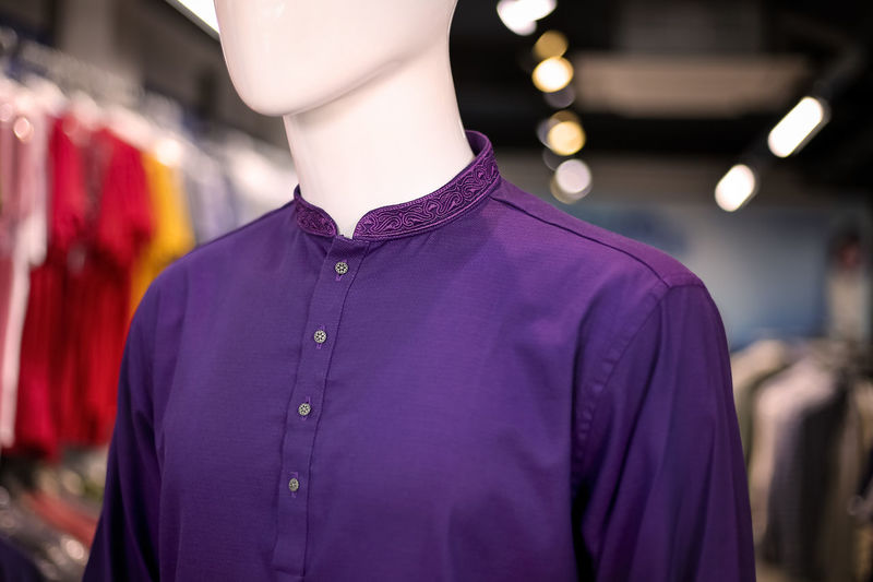 Close-up of purple kurta on mannequin in store
