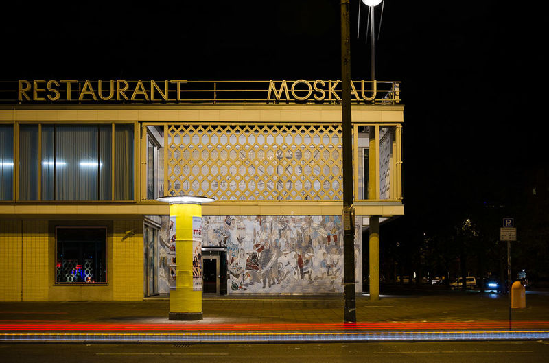 View of yellow building at night