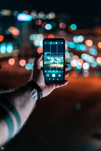 Did someone say Bokeh?! Human Hand Wireless Technology Hand Communication Technology Smart Phone Portable Information Device Mobile Phone Human Body Part Illuminated Connection Holding One Person Photographing Real People Screen Photography Themes Focus On Foreground Night City Outdoors Finger