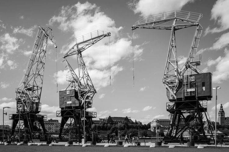 Dźwigozaury. Renovated port cranes located at Szczecin boulevard. Architecture Crane - Construction Machinery Built Structure Industry Construction Industry Machinery Steel Structure  Metal Waterfront Harbour Cloud - Sky Day Outdoors Transportation Mode Of Transportation Arts Culture And Entertainment Black And White High Contrast EyeEm Best Shots EyeEm Selects