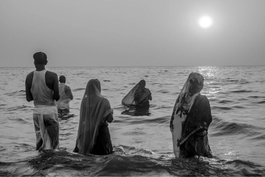Worshippers on the beach front. Mumbai Indian Culture  Horizon Over Water Sea Women Worshippers Festivals Of India