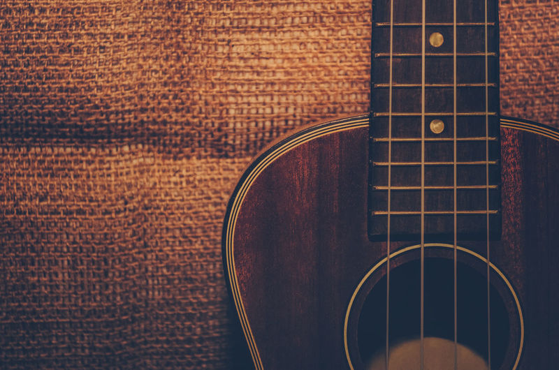 Close-Up Of Guitar On Burlap