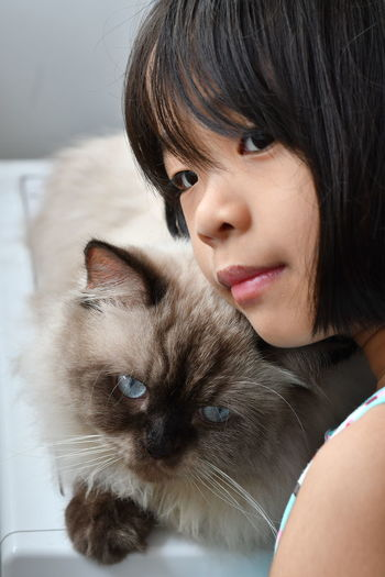 Close-up of girl with cat