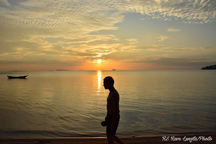 Sunset Reflection Beach One Person Silhouette Water Full Length Tranquility Sun Beauty In Nature Horizon Over Water Sea Standing Only Women Sky People Nature One Woman Only Landscape Tranquil Scene Nautical Vessel Tropical Climate Lifestyles Horizon Nature