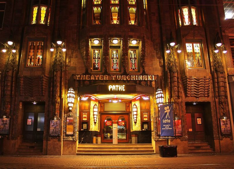 One of the most beautiful theaters in the world Learn & Shoot : After Dark Theater Tuschinski Theatre Movie Theater Nightphotography Night Lights Night Street Photography Night Street Night City Life Amaterdam Cityscapes Architecture Facade Architecture Details Night Photography Cities At Night The Street Photographer - 2016 EyeEm Awards 43 Golden Moments Miles Away