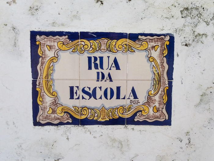 """Portugal EyeEm ZOOM in to see details... Constância, almost all street names in this town are hand painted on """"azulejos"""": https://en.wikipedia.org/wiki/Azulejo. Here are some examples of this beautiful Art... Communication Text Western Script Wall - Building Feature No People Architecture Built Structure Day Sign Information Script Non-western Script White Color Design Outdoors Blue Close-up Yellow Information Sign Capital Letter Message"""