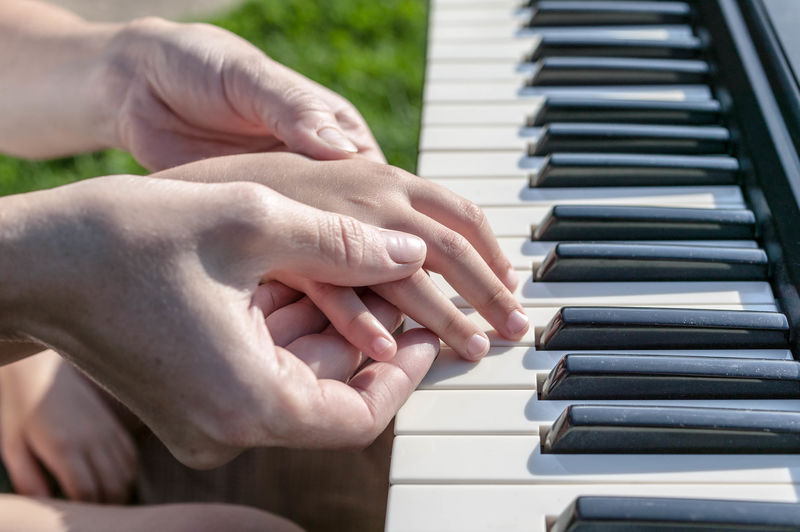 Concept Mother's Day Female And Children's Hands Mother Teaches The Daughter To Play The Piano Adult Body Part Bonding Finger Hand Human Body Part Human Finger Human Hand Love Music Musical Equipment Musical Instrument People Piano Piano Key Playing Positive Emotion Togetherness Two People Women