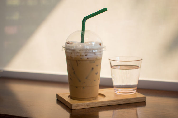 Bevarage Capuccino Close-up Day Drink Drinking Glass Drinking Straw Enjoying Life Focus On Foreground Food And Drink Freshness Healthy Eating Icedcapuccino Icedcoffee Indoors  Lighting No People Pure Refreshment Saucer Table Water