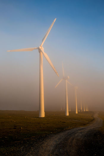 Earth, wind and fire Serra Da Capelada, Galicia Alternative Energy At Sunset Environmental Conservation Fog Fuel And Power Generation Industrial Windmill No People Renewable Energy Sky Technology Wind Power Wind Turbine Windmill