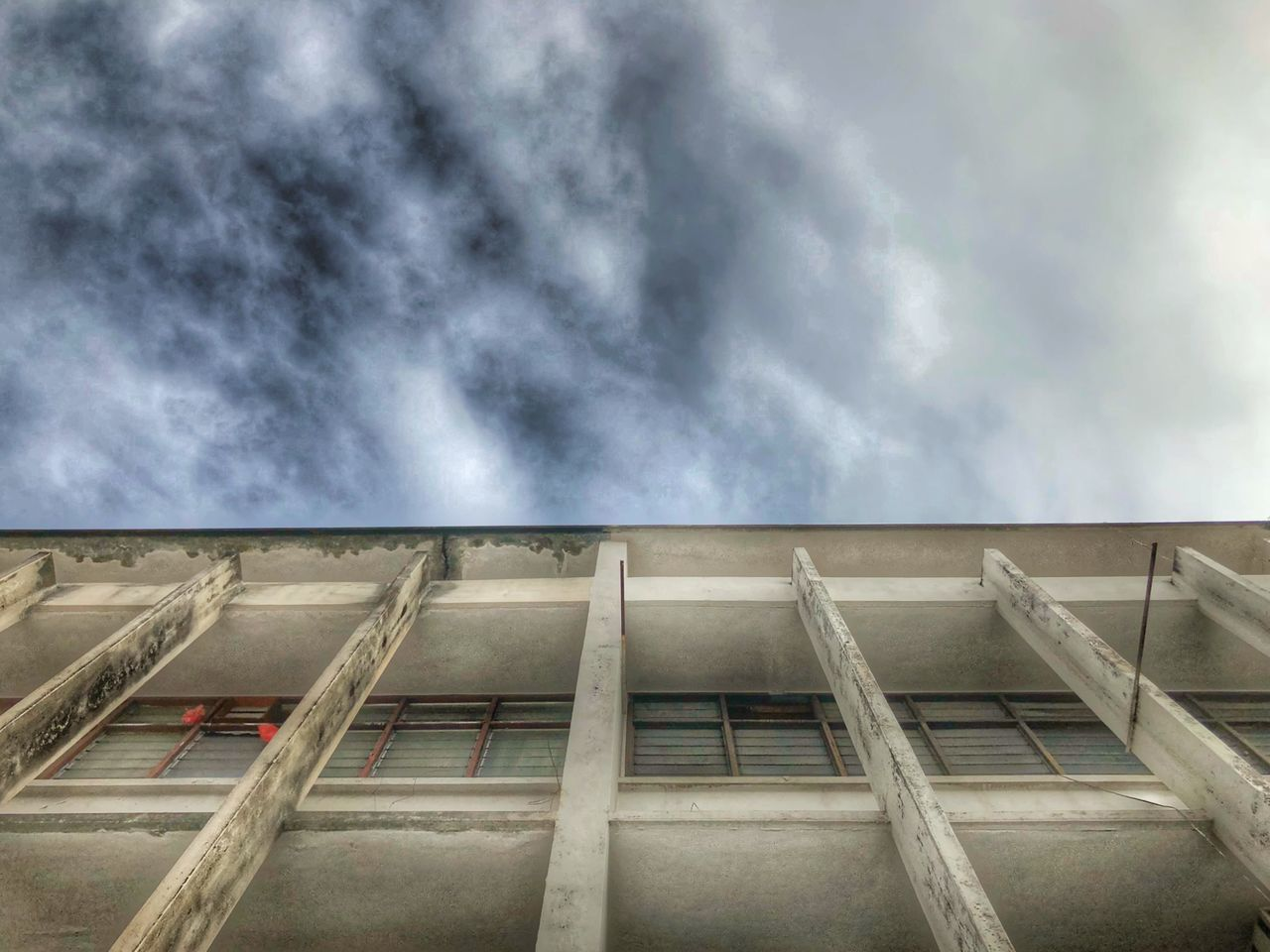 cloud - sky, sky, architecture, building exterior, low angle view, built structure, nature, no people, day, outdoors, industry, building, city, roof, overcast, wet, environment, window, residential district