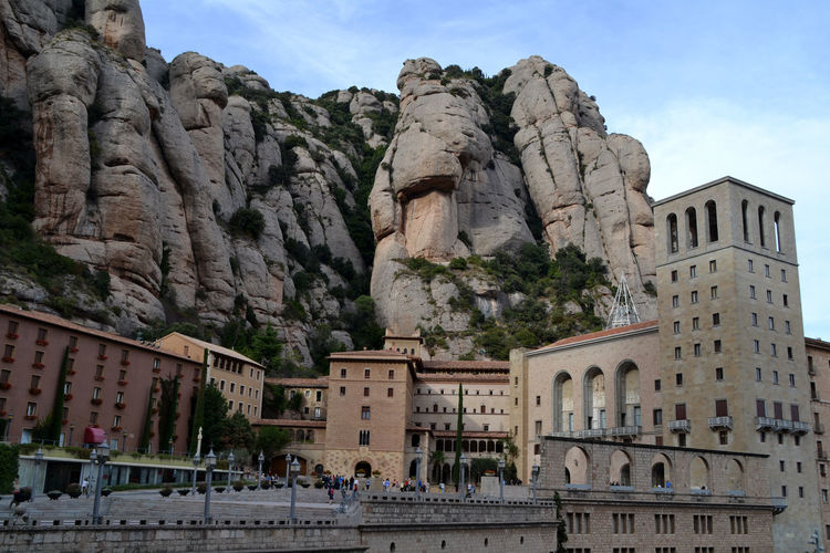 Santa maria de montserrat abbey against rocky mountain
