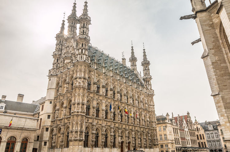 Old town hall of Leuven Belgium Architecture Belgium Building Exterior Built Structure City Clock Tower Day History Leuven Leuven, Belgium Low Angle View Medieval No People Outdoors Place Of Worship Religion Sky Spirituality Town Hall Travel Destinations