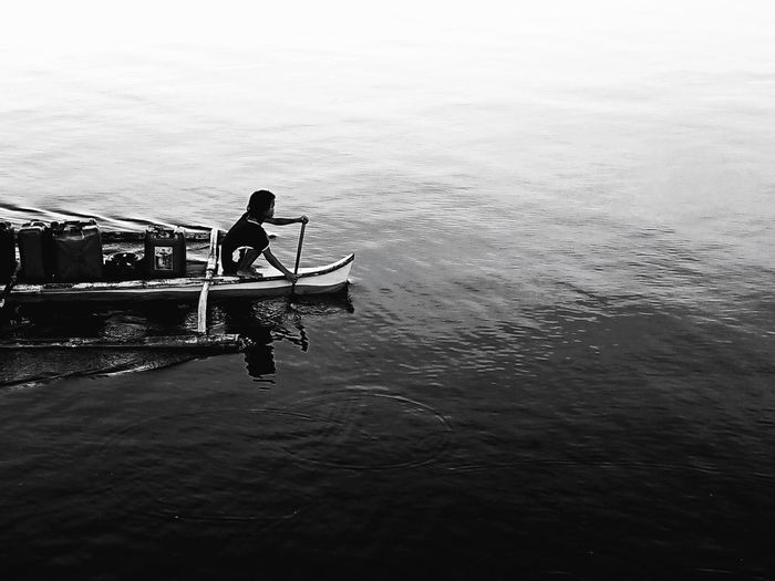 """ Rewatering for drinking water "" Blackandwhite Photography Bnw Blackandwhite Minimalist XperiaXZ1 Sony Sonyxperia JOLO Sulu Philippines Xperiaphotography XperienceXZ1 XPERIA Bangka EyeEm Best Shots Dailyphoto EyeEmNewHere EyeEm Gondola - Traditional Boat Water Nautical Vessel Rowing Men Oar Occupation Standing Sky Fisherman Rowboat Fishing Boat Be Brave"