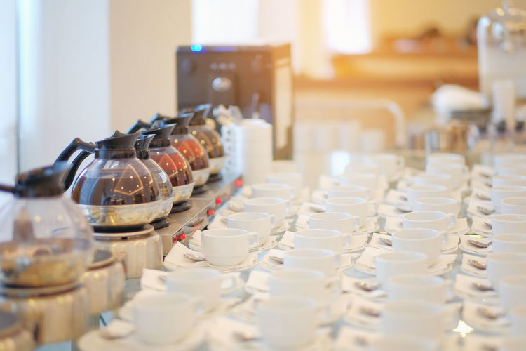 Close-Up Of Teapots And Cups Arranged On Table