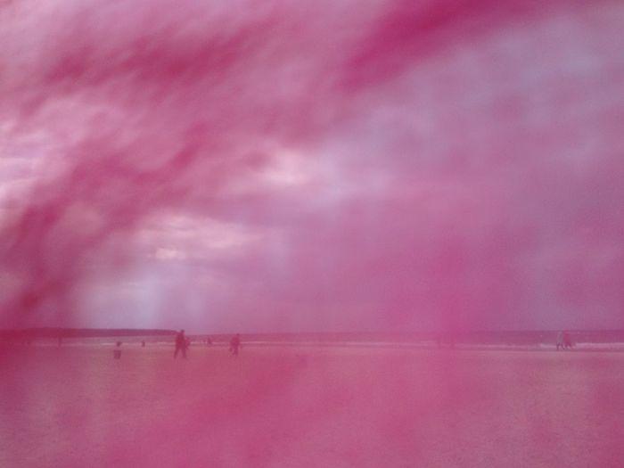 Pink sea against sky