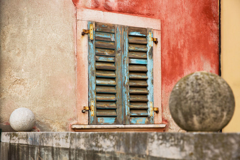 Architecture Ball Blue Building Building Exterior Built Structure Close-up Closed Window  Day House No People Old Outdoors Pattern Red Color Rusty Shutter Sunlight Wall Wall - Building Feature Weathered Window Windows Wood - Material Yellow Color