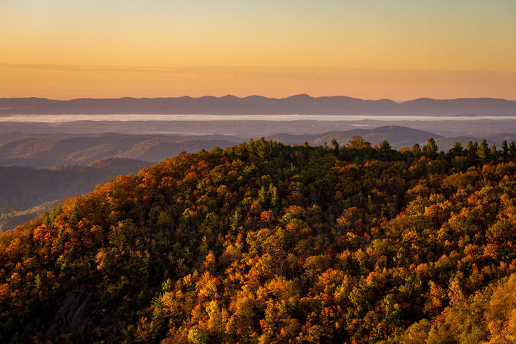 Scenic view of mountains during sunset in autumn