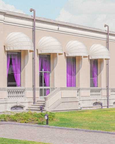 Office Space Architecture Building Exterior Built Structure No People Sky Nature Day Building Grass Purple Side By Side Architectural Column Outdoors Glass - Material Window City In A Row Railing Sunlight Plant