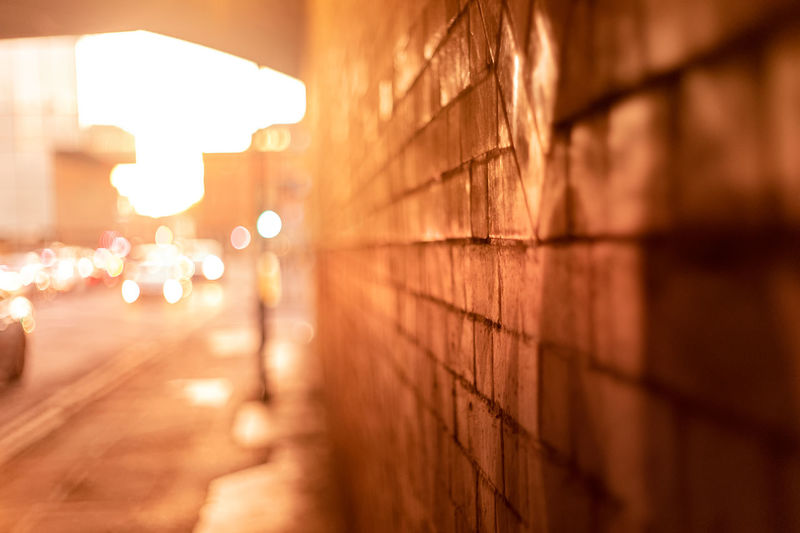 Architecture Illuminated Built Structure Wall - Building Feature Selective Focus No People Sky Night Outdoors Footpath The Way Forward City Nature Direction Lighting Equipment Sunset Focus On Foreground Street Wall Lens Flare