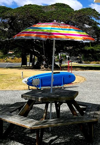 Vibrantly coloured sun umbrella and pick nic table. Outdoors The Week On EyeEem Travel Destinations Scenics EyeEm Best Shots Ladyphotographerofthemonth Tutukaka Shopping Bullavard In Whangarei New Zealand Be. Ready.