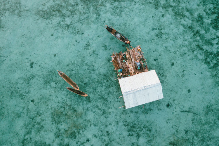 High angle view of a boat floating on sea