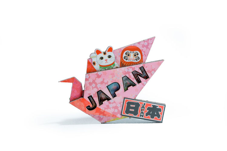 Japan fridge magnet with origami White Background Studio Shot Representation Human Representation Still Life Indoors  Cut Out No People Copy Space Creativity Text Close-up Art And Craft Toy Communication Male Likeness Number Paper Western Script Japan Fridge Magnets Survineur
