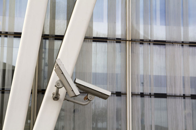 Video camera for surveillance and security Architecture Building Building Exterior Built Structure Cam Camera Equipment Glass No People Outdoors Security Security Cam Security System Spy Steel Structure Surveillance Survey System Video Videocamera