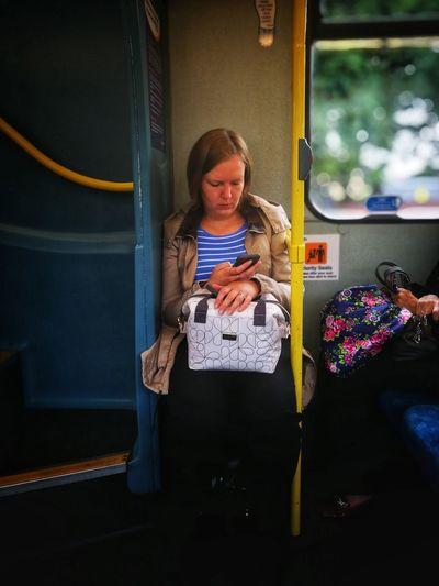 Full length of a girl holding train