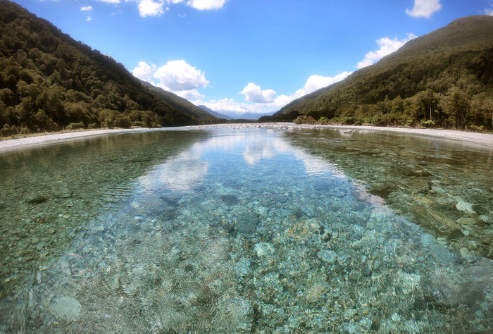 Beauty In Nature Blue Canyon Clear Water Cloud - Sky crystal clear Day Environment Floating On Water Landscape Mountain Nature New Zealand Outdoors Purity Reflection River Scenics - Nature Shallow Sky Tranquil Scene Tranquility Water Waterfront