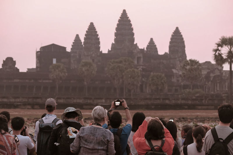 Tourists being tourists. 10 Angkor Wat, Cambodia Cambodia The Traveler - 2018 EyeEm Awards Tourisme Tourist Tourist Attraction  Adult Angkor Wat Crowd Group Of People History Large Group Of People Lifestyles Outdoors Photography Real People Sunrise Sunrise_sunsets_aroundworld Tourism Tourism Destination Tourist Destination Tourist Photography Travel Travel Destinations