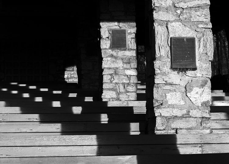Architecture Black And White Photography Building Exterior Built Structure Chapel Contrast Historical Outdoors Pews Pillar Plaque Pretty Place Shadow Stone Pillars Sunlight Sunrise Vanishing Point Wooden Bench Wooden Benches