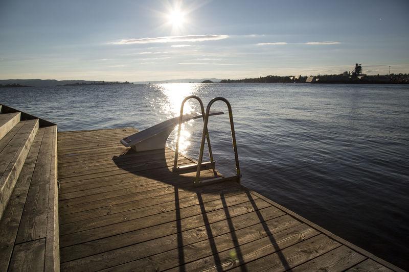 Diving platform on boardwalk by lake
