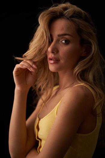 Portrait One Person Young Adult Women Beautiful Woman Beauty Black Background Studio Shot Hair Indoors  Adult Looking At Camera Side View Hairstyle Young Women Headshot Blond Hair Long Hair Contemplation Dark Human Hair First Eyeem Photo