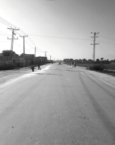 roadside things Empty Road Roadsidephotography Black & White Telephone Line Electricity Pylon City Road Clear Sky Antenna - Aerial Winter