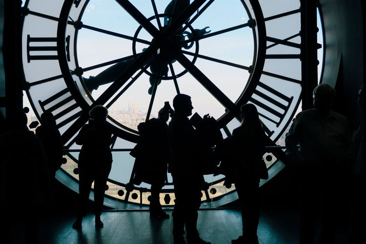Roman Numeral Clock Silhouette Clock Face Time Ferris Wheel Adults Only Low Angle View People Standing Minute Hand Day Indoors  Hour Hand Adult Astronomical Clock Only Men Sky EyeEm Selects Paris Parisienne Paris, France  D'Orsay Arts Culture And Entertainment Dorsay Museum