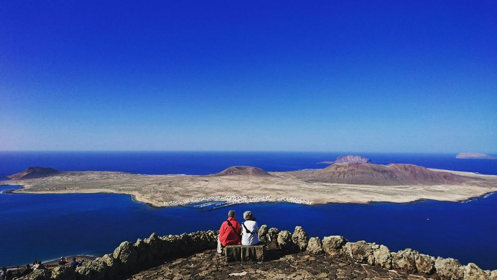 Travelling. Together. Two People Beauty In Nature Mountain Scenics People Couple Together Couples Shoot Togetherness Lanzarote-Canarias Lanzarote Landscape Beauty In Nature Coastline Island In The Sun Nature Landscapes Amazing View Colors Of Nature Let's Go. Together. Love Is Love