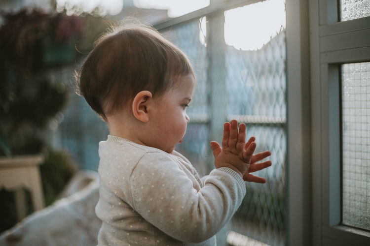 Hands Child Childhood Children Family Family With One Child Family Matters One Person Real People Innocence Focus On Foreground Lifestyles Side View Day Baby Cute Headshot Window Young Portrait Indoors  Standing Human Arm Arms Raised Love Togetherness