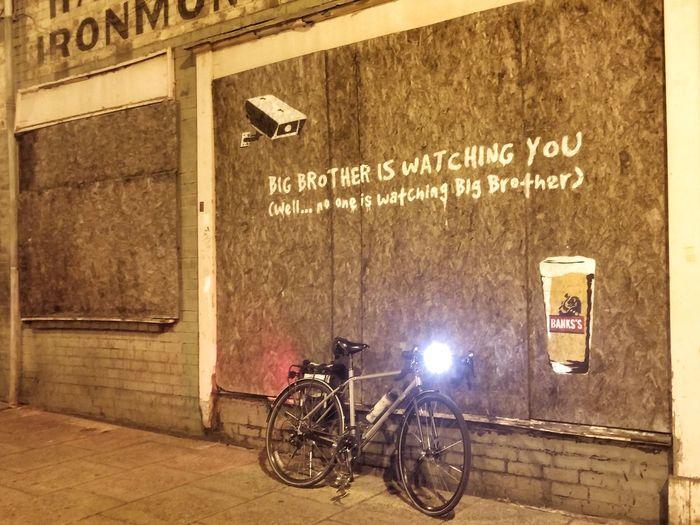 Bicycle Mode Of Transport Transportation Text Communication City Night Outdoors Building Exterior Bike Life Bikeporn Bikesaroundtheworld Cctv Cctv Camera Surveillance Camera Bici Exterior Building City Bicicleta Surveillance Big Brother - Orwellian Concept