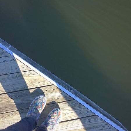 Low Section Human Leg Personal Perspective Human Foot Shoe Human Body Part One Person Real People Leisure Activity Lifestyles Women Standing Outdoors Water Day Men Canvas Shoe Sky Close-up Adult Out Of The Box